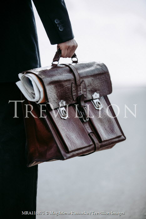Magdalena Russocka close up of man holding briefcase