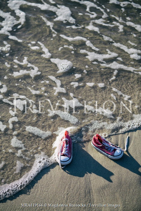 Magdalena Russocka childs sneakers on sandy beach