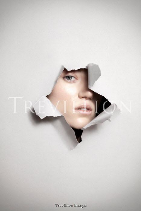 Miguel Sobreira Woman Looking Through Torn Paper Women