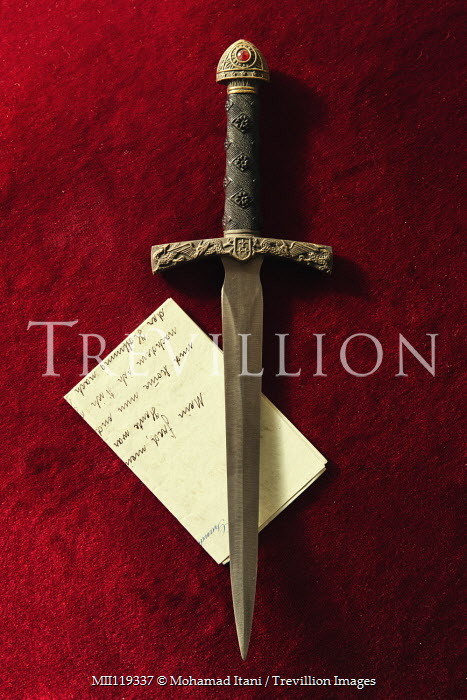 Mohamad Itani Dagger and handwritten letter on red background