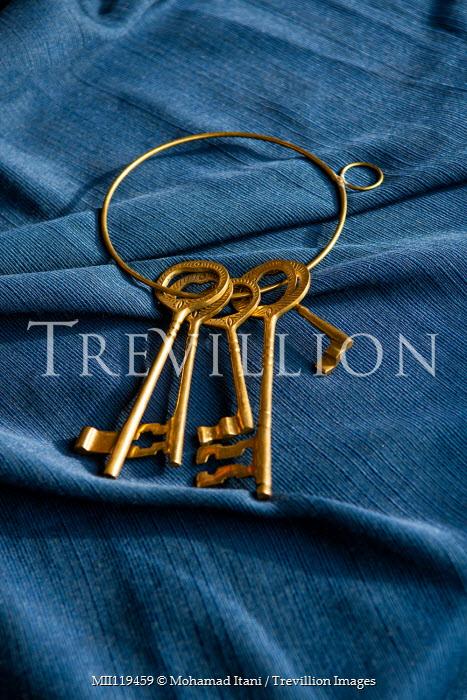 Mohamad Itani Antique keys on blue fabric