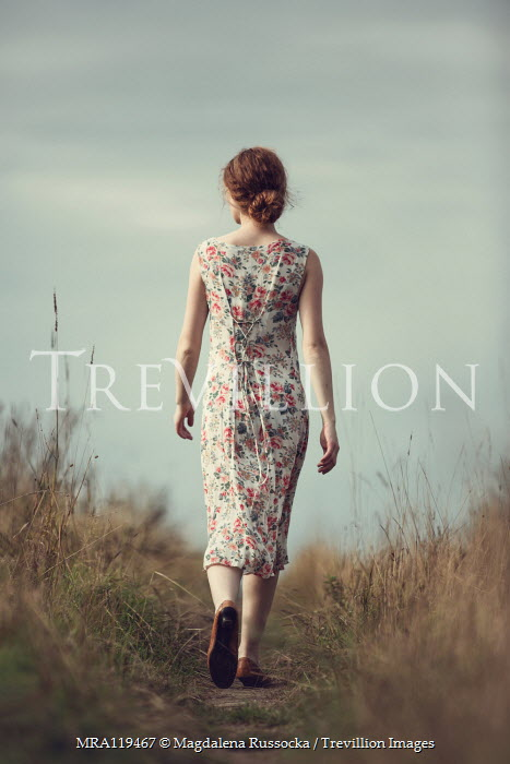 Magdalena Russocka woman in floral dress walking in countryside