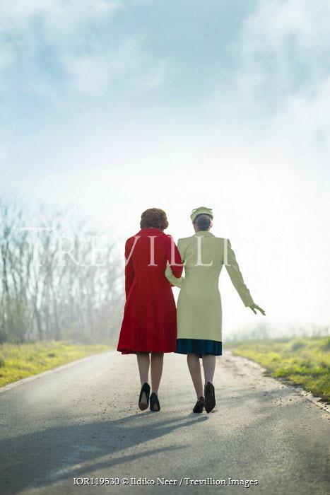 Ildiko Neer Two vintage women walking on country road
