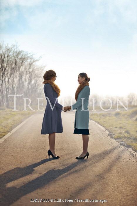 Ildiko Neer Two vintage women standing on country road