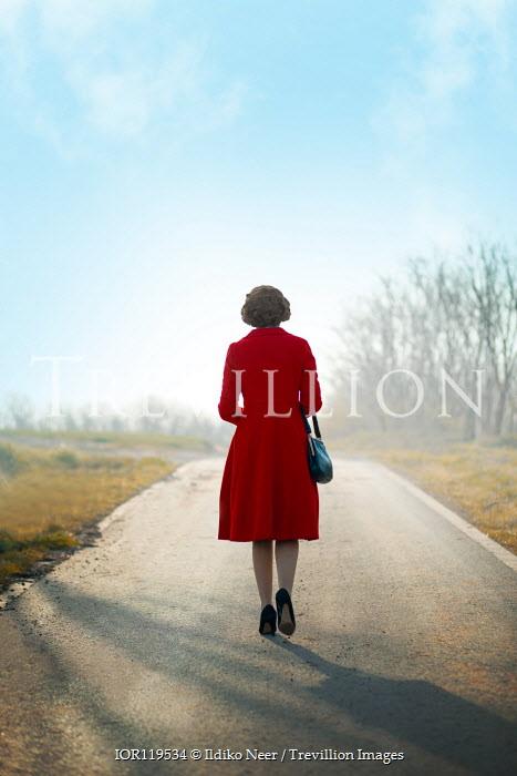 Ildiko Neer Vintage woman walking on country road