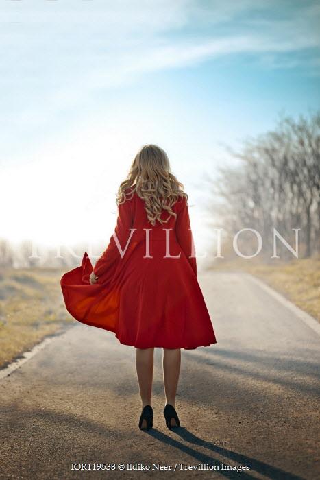 Ildiko Neer Blonde woman standing on country road