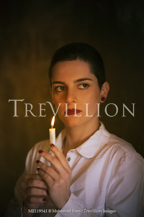 Mohamad Itani Young woman with short hair holding candle Women