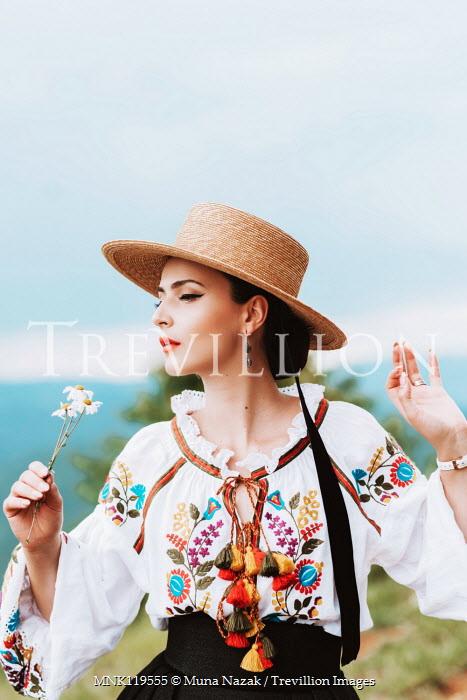 Muna Nazak Young woman in straw hat holding daisy Women