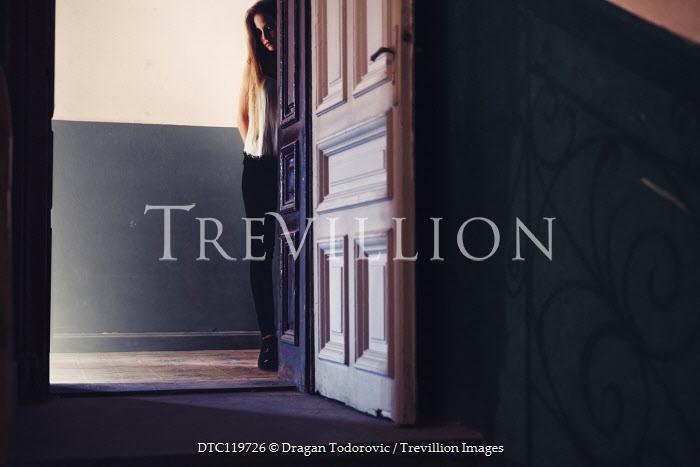 Dragan Todorovic SAD TEENAGE GIRL WATCHING AT DOORWAY IN HOUSE Women