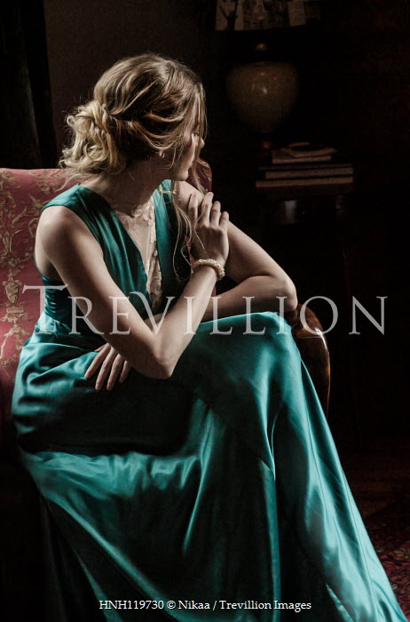 Nikaa LONDE WOMAN IN SILK DRESS SITTING INDOORS Women