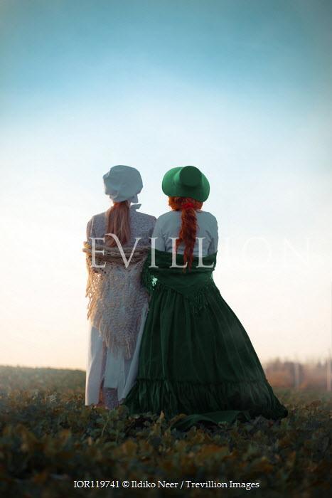 Ildiko Neer Two historical women standing in field