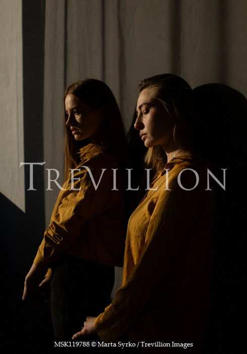 Marta Syrko TWO SERIOUS WOMEN IN SHADOW BY WALL Women