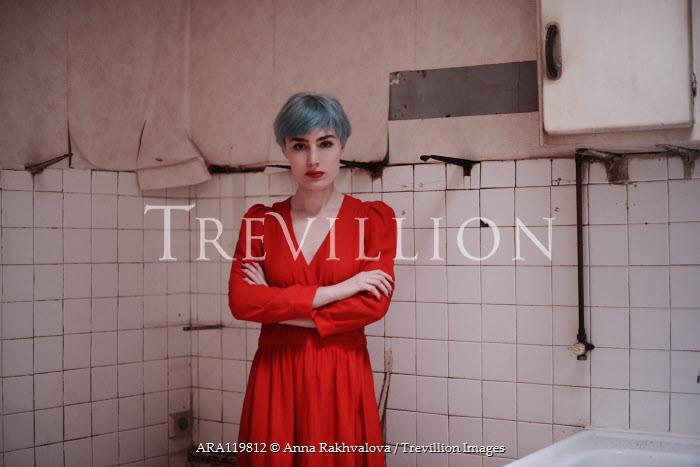 Anna Rakhvalova WOMAN IN RED STANDING IN DERELICT INTERIOR Women