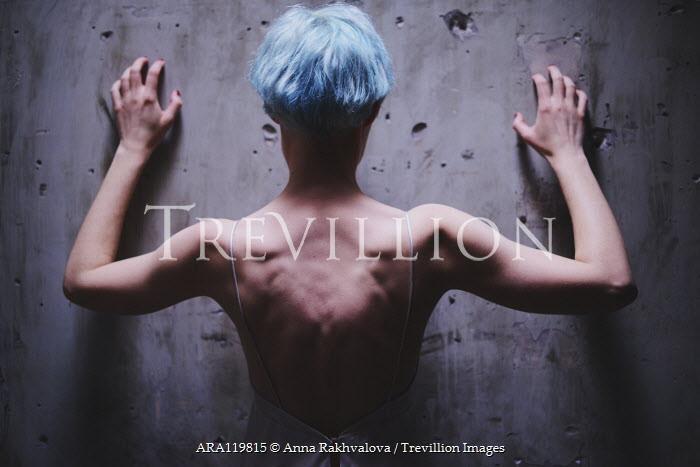 Anna Rakhvalova WOMAN WITH BLUE HAIR SCRATCHING WALL INDOORS Women
