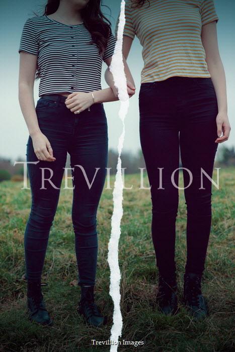 Rekha Garton TWO GIRLS STANDING IN FIELD WITH TEAR Women
