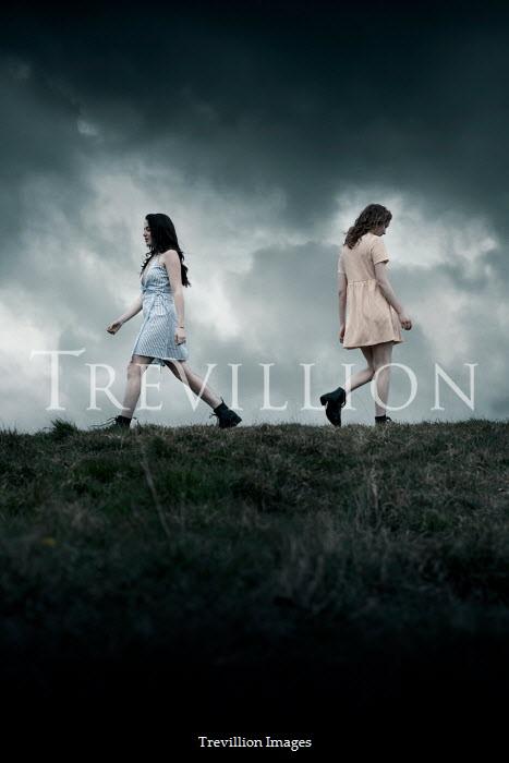 Rekha Garton TWO GIRLS WALKING IN FIELD AT DUSK Women