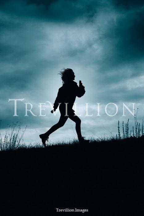 Rekha Garton SILHOUETTED GIRL RUNNING IN FIELD WITH GUN Women