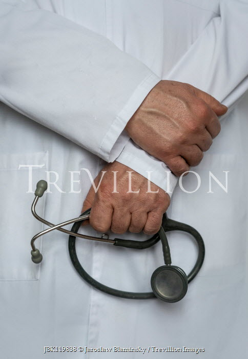 Jaroslaw Blaminsky CLOSE UP OF MAEL HANDS HOLDING STETHOSCOPE Men