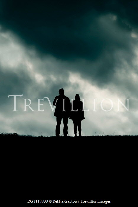 Rekha Garton SILHOUETTED MAN AND WOMAN IN FIELD AT DUSK Couples