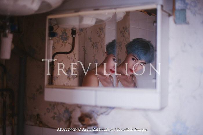 Anna Rakhvalova REFLECTION OF WOMAN WITH BLUE HAIR IN SHABBY BATHROOM Women