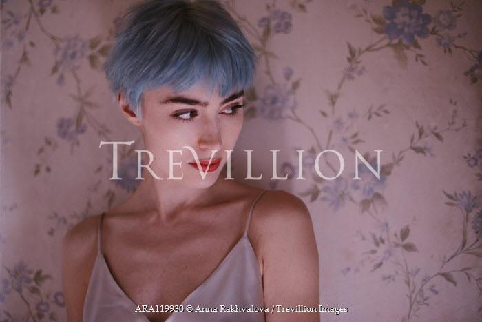 Anna Rakhvalova WOMAN WITH BLUE HAIR BY PINK FLORAL WALLPAPER Women