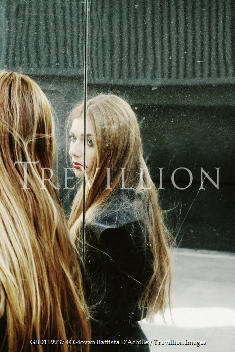 Giovan Battista D'Achille SAD GIRL WITH LONG HAIR REFLECTED IN GLASS BUILDING Women
