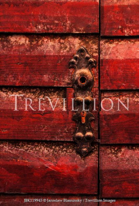 Jaroslaw Blaminsky CLOSE UP OF RED WOODEN DOOR WITH DECORATIVE LOCK Building Detail