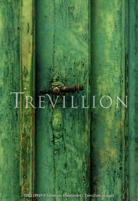 Jaroslaw Blaminsky CLOSE UP OF WEATHERED GREEN DOOR WITH HANDLE Building Detail