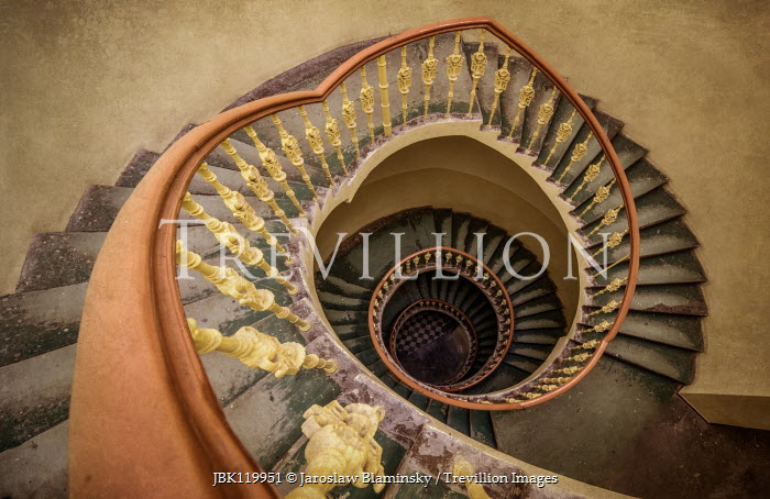 Jaroslaw Blaminsky EMPTY SHABBY SPIRAL STAIRCASE FROM ABOVE Stairs/Steps