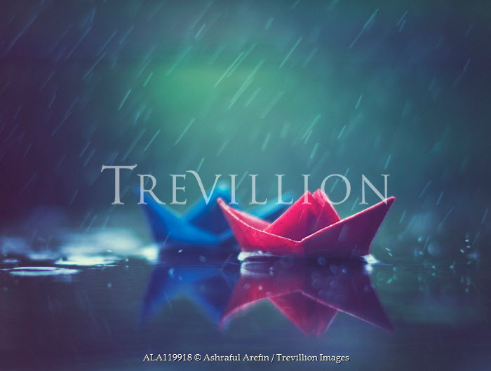 Ashraful Arefin TWO PAPER BOATS FLOATING ON PUDDLE IN RAIN Miscellaneous Objects