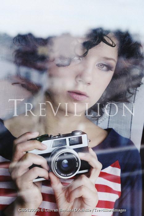 Giovan Battista D'Achille Woman with camera behind window
