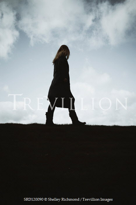 Shelley Richmond Woman in coat walking on hill