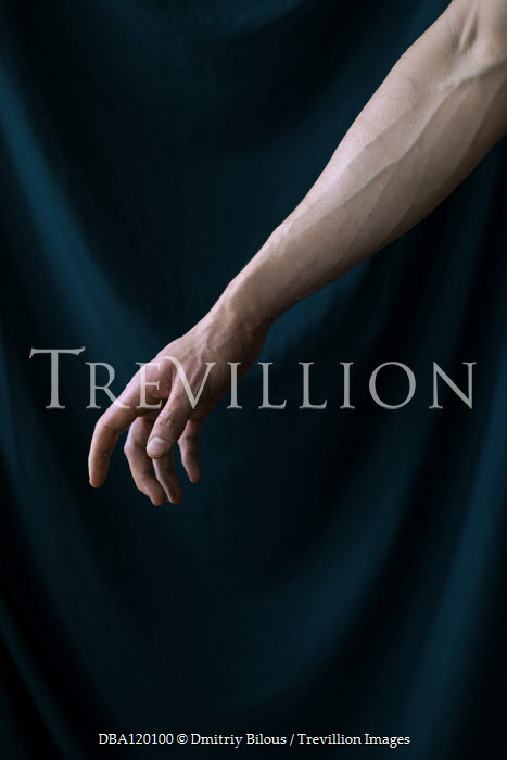 Dmitriy Bilous Arm of man by curtain