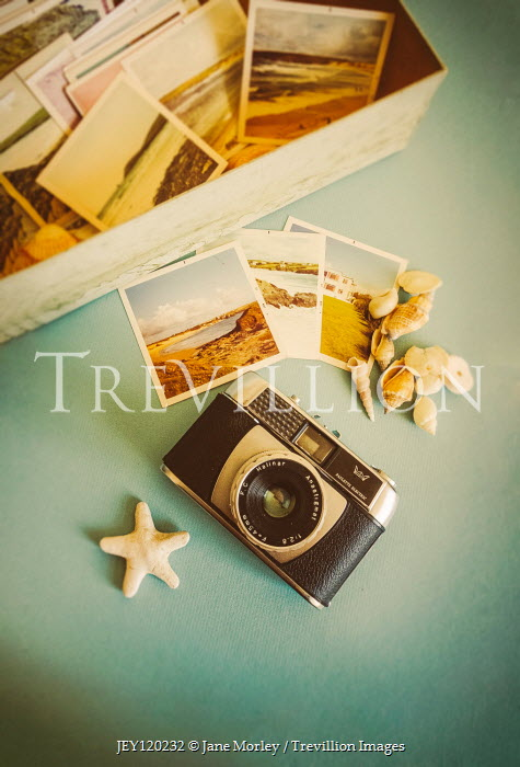 Jane Morley RETRO CAMERA WITH SEASHELLS AND BOX OF PHOTOGRAPHS Miscellaneous Objects