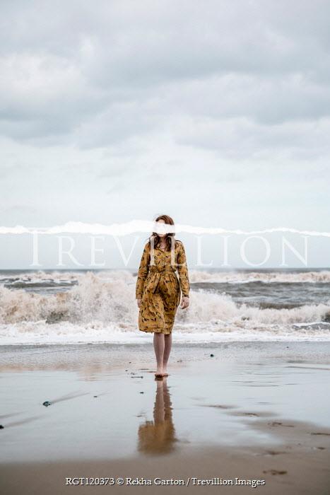 Rekha Garton WOMAN WITH RED HAIR ON BEACH WITH HORIZONTAL TEAR Women