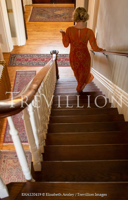 Elisabeth Ansley BLONDE WOMAN DESCENDING STAIRCASE FROM BEHIND Women