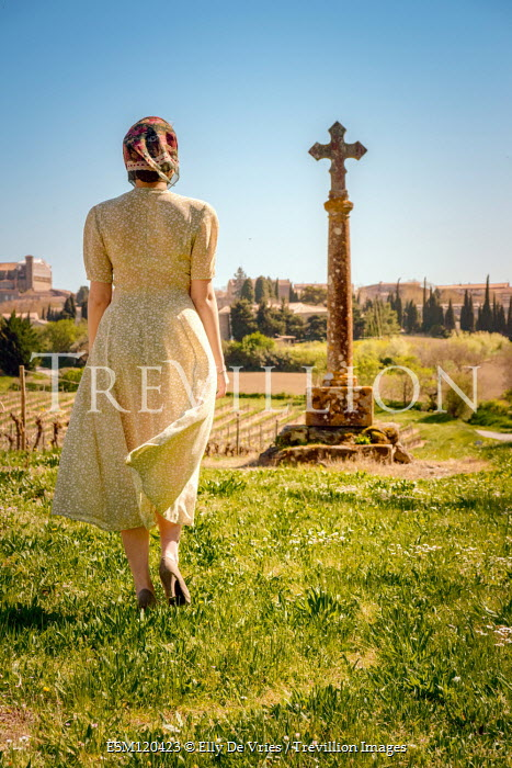 Elly De Vries WOMAN WALKING BY MONUMENT IN COUNTRYSIDE Women
