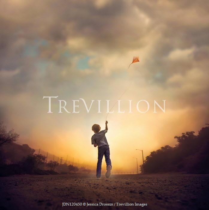Jessica Drossin BOY FLYING KITE AT SUNSET Children