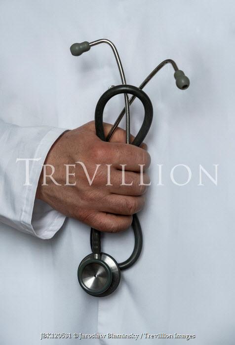 Jaroslaw Blaminsky Hand of doctor holding stethoscope