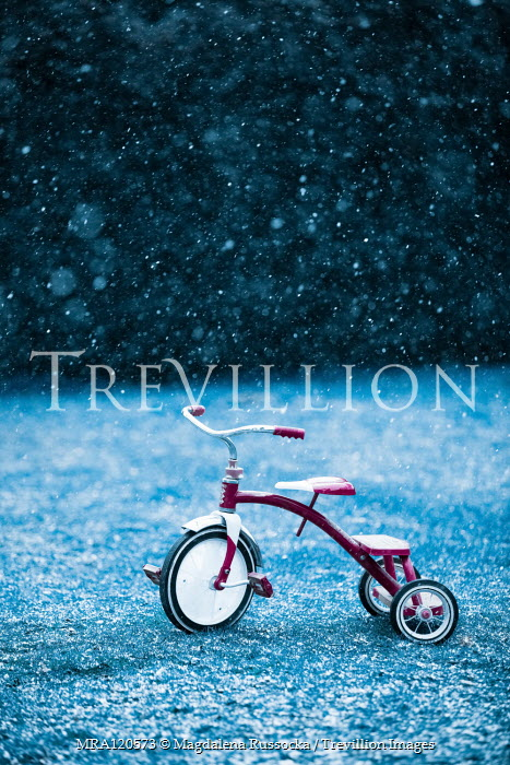 Magdalena Russocka tricycle abandoned in snowy garden