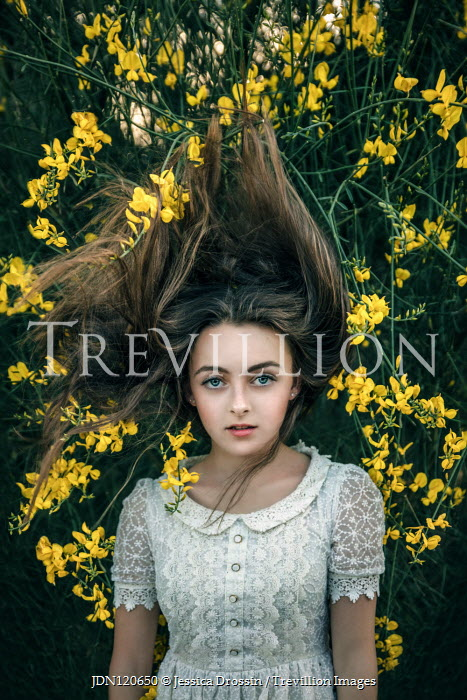 Jessica Drossin Teenage girl with hair tangled in branches with yellow flowers