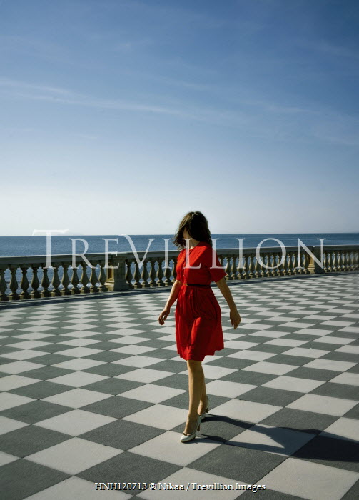 Nikaa BRUNETTE WOMAN WALKING ON TERRACE BY SEA Women