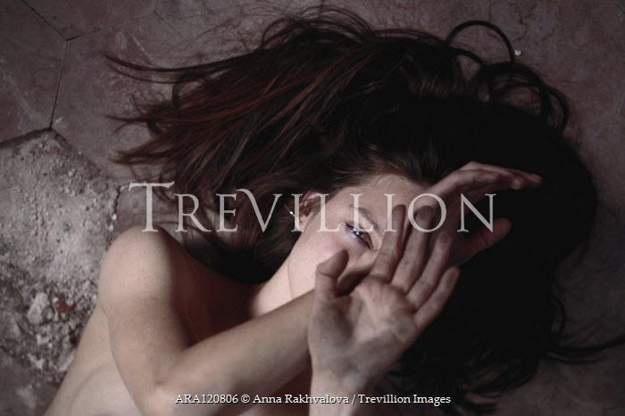 Anna Rakhvalova SCARED NUDE WOMAN LYING ON DIRTY FLOOR Women