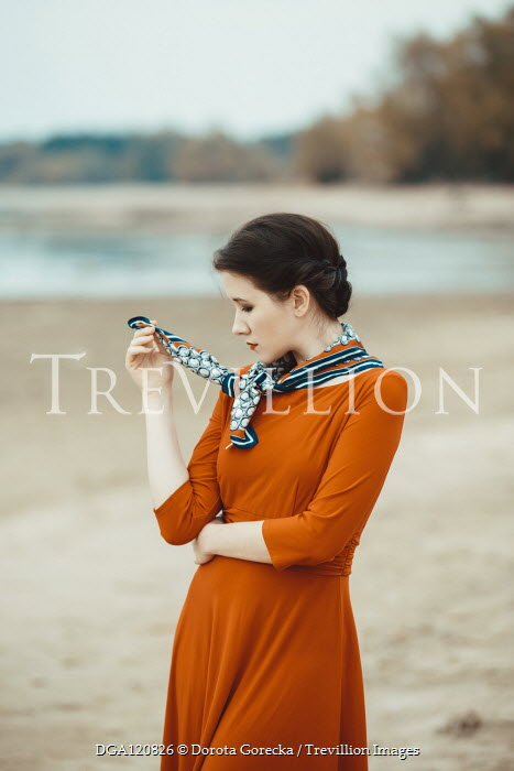 Dorota Gorecka SERIOUS BRUNETTE WOMAN WITH SCARF ON BEACH Women