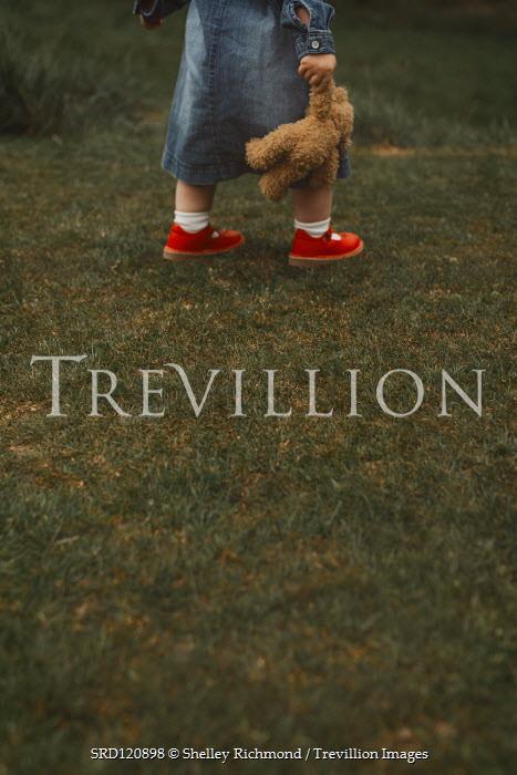 Shelley Richmond LITTLE GIRL CARRYING TEDDY IN GARDEN Children