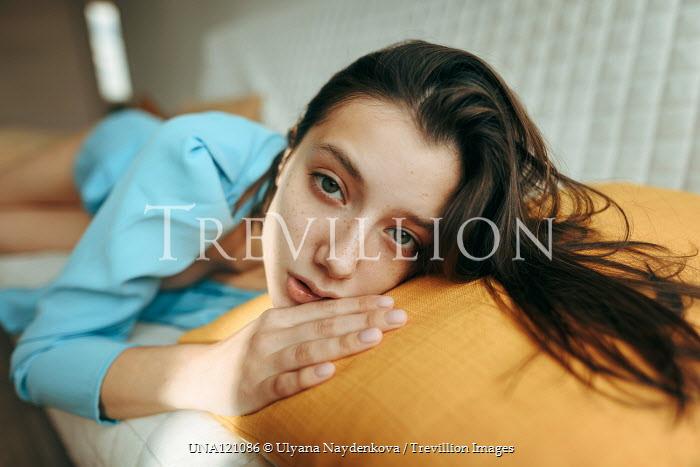 Ulyana Naydenkova Young woman lying on couch