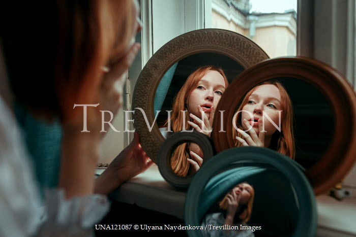 Ulyana Naydenkova Reflection of young woman in mirrors
