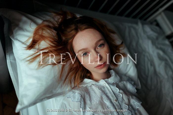 Ulyana Naydenkova Young woman lying on bed