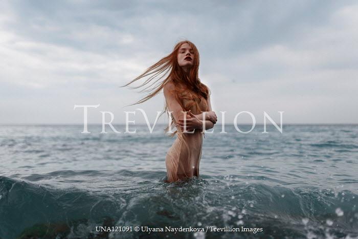 Ulyana Naydenkova Young woman standing in sea