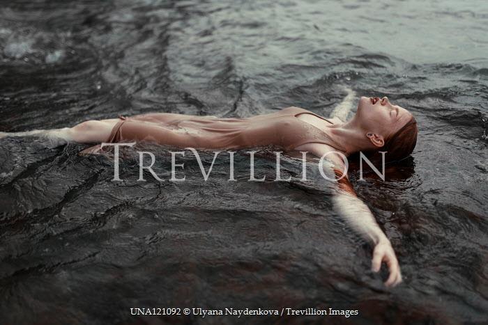 Ulyana Naydenkova Young woman floating in sea